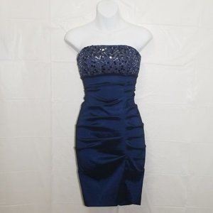 Navy ruched dress with embellished bust